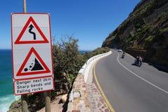 Danger curves. Warning sign, falling rocks on Chapman's Peak Drive Cape Town Stock Photo