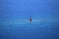 Danger d'isolement sur la mer photographie stock