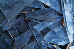 Danger and damage. Shards of broken glass, blue. Background on the topic of the danger and damage Royalty Free Stock Images
