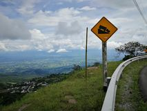 Danger. Post on street moutain Royalty Free Stock Photography