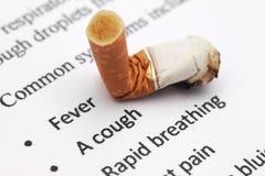 Danger de cigarette Photographie stock