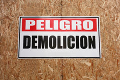 Danger Demolition. A sign on a wall in Spanish that reads: Danger Demolition stock images