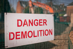 Danger Demolition sign. Warning sign spelling Danger Demolition on a building site in London Royalty Free Stock Images
