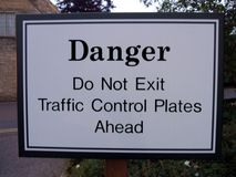 Danger Do Not Exit Traffic Control Plates Ahead Sign. Sign for drivers warning them on a road royalty free stock photography