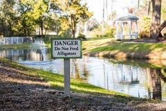 Danger Do Not Feed Alligators Stock Foto's