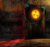Danger door. Open danger door with radiation caution sign in old technology building Stock Photo