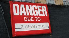 Danger due to zombies sign stock photography