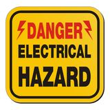Danger electrical hazard - yellow sign Stock Photos