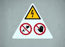 Danger electricity warning sign. don`t touch, don`t throw water stock image