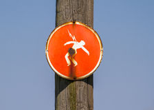 Danger of electrocution red sign. Electrocution warning sign on a wooden electric pole stock images