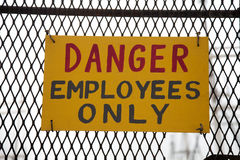 Danger employees only. Handwritten sign Danger employees only Stock Images