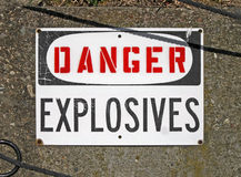 Danger explosives, warning message on signboard, Stock Photos