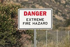 Danger Extreme Fire Hazard Sign. In dry brush mountain canyon stock images