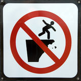 Danger falling risk warning sign Stock Photography