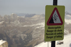 Danger of falling sign in Switzerland Stock Photography