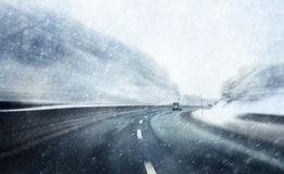 Danger fast speed driving in snowfall Royalty Free Stock Photo