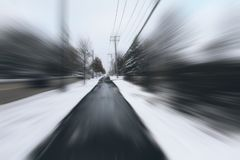 Danger and fast turn at the icy snow road. Abstract motion blur background. Danger and fast turn at the icy snow road Stock Image