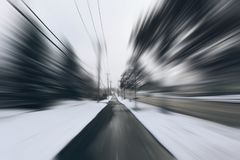 Danger and fast turn at the icy snow road. Abstract motion blur background. Danger and fast turn at the icy snow road Royalty Free Stock Photos