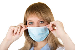 Danger Flu epidemic. Closeup of a doctor with protection mask Royalty Free Stock Image