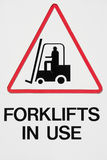 Danger, Forklifts in Use. Forklifts in Use Sign with White Background Royalty Free Stock Photo