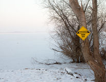 Danger frozen ice ahead. Sign warning people of the dangers of the thin lice stock images