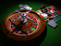 Danger of games. Poker cards, a heap of  hundred dollars bills, a casino roulette, 2 dices, 2 dollars coins, a revolver and some bullets Royalty Free Stock Photos