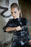 Danger girl with knife Stock Photo