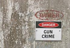 Danger, Gun Crime warning sign. Red, black and white Danger, Gun Crime warning sign royalty free stock images