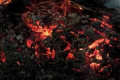 Danger, hazard, energy concept. Lava flame on black ash background. Magma textured molten rock surface. Volcano, fire, crust. Formation geology nature royalty free stock images