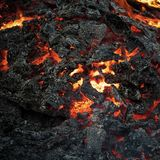 Danger, hazard, energy concept. Lava flame on black ash background. Formation, geology, nature, environment. Magma textured molten rock surface Volcano fire stock image