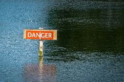 Danger Hazard Warning Sign in River Royalty Free Stock Photography