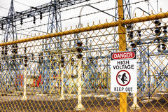 Danger High Voltage Keep Out. Many electrical substations have fences and warning signs to keep out Royalty Free Stock Photo