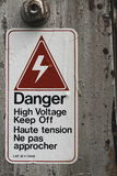 Danger. High Voltage Sign  in English and French Stock Photo