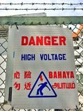Danger high voltage sign in four official languages in Singapore Royalty Free Stock Images