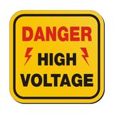 Danger high voltage - yellow sign Stock Photo