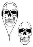 Danger human skull in headphones Stock Photos