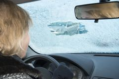 Danger from icy windshield in the car stock photo