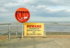 Danger incoming tides sign Royalty Free Stock Photos
