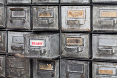 Danger information concept image. Opened box archive storage, filing cabinet interior. metal boxes with index cards Royalty Free Stock Images
