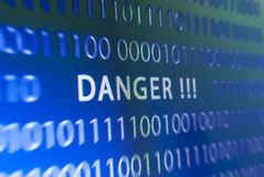 Danger inscription on monitor. Inscription danger on blue computer screen or monitor Stock Photo
