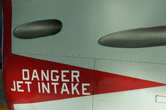 Danger jet intake warning on airplane side wall. Warning of jet intake danger on jet at Evergreen Aviation Museum, McMinnville, Oregon stock image