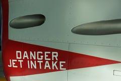 Danger jet intake warning on airplane side wall. Warning of jet intake danger on jet at Evergreen Aviation Museum, McMinnville, Oregon stock image