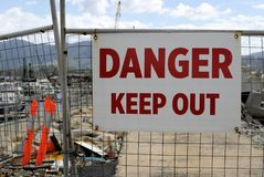 `Danger Keep Out Authorised Personnel Only` sign board on fence gate at construction site. `Danger Keep Out Authorized Personnel Only` sign board on fence gate stock image