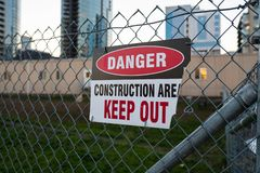 `Danger, keep out, construction area` sign on the fence. stock photo