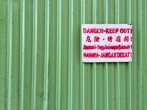 Danger. Keep out. A shot of Danger - Keep Out sign translated into a few different languages. The shot was taken at a construction site in Tampines, Singapore Stock Photos