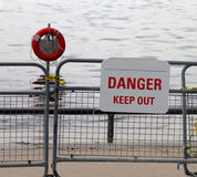 Danger Keep Out. A sign on a fence warning people ,Danger Keep Out of the water Stock Image