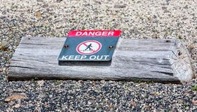 Danger Keep Out Sign. Keep out or no trespassing sign on a cut log Stock Photos