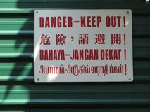 Danger - Keep Out!. Signboard in four languages stating Danger - Keep Out royalty free stock photo