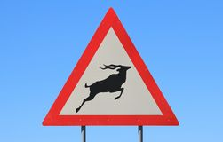 Danger - Kudu and Wildlife Crossing Road Sign - Road Hogs watch out for the pigs stock photo