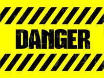 Danger label in black and yellow Royalty Free Stock Image